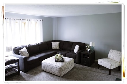 a picture of a living room carpeted by Carpet Warehouse